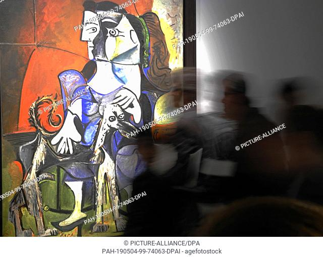 """03 May 2019, US, New York: At Sotheby's, visitors can admire the painting """"""""femme au chien"""""""" by Pablo Picasso. The auction house Sotheby's has reopened its..."""