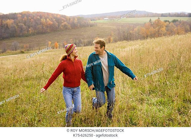 Caucasian couple, age 30's to 40's, autumn, running, hills, outdoors