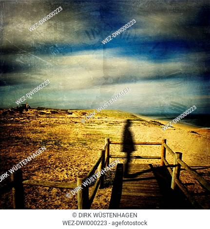 France, Contis-Plage, Silhouette of a man on wooden boardwalk