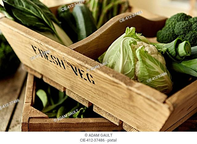Still life fresh, organic, healthy, green vegetables in wooden crate