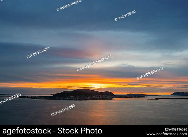 Alesund, Norway. Amazing Natural Bright Dramatic Sky Above Alesund Valderoya And Islands In Sunset Time. Colorful Sky Background