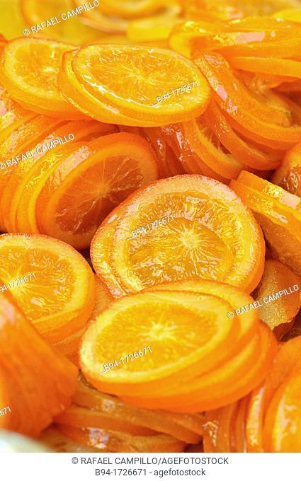 Orange slices in syrup, Sant Ponç fair on 11th May, Carrer de l'Hospital street, Barcelona, Catalonia, Spain