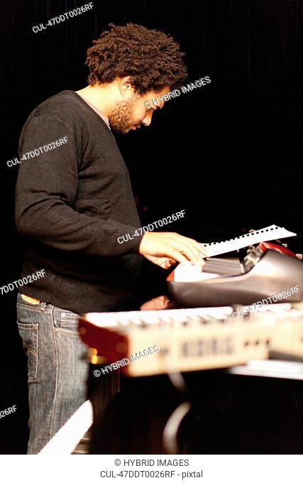 Piano player reading sheet music