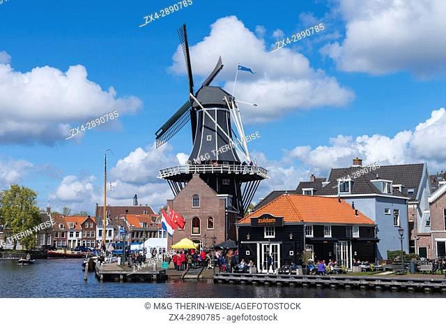 De Adriaan windmill along the river Spaarne, Haarlem, North Holland, The Netherlands