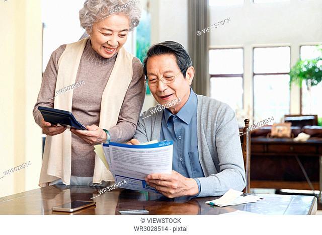 Elderly couples are managing finances