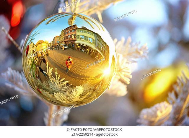 Typical half-timbering houses reflected on a Christmas bauble. Colmar. Haut-Rhin. Alsace. France