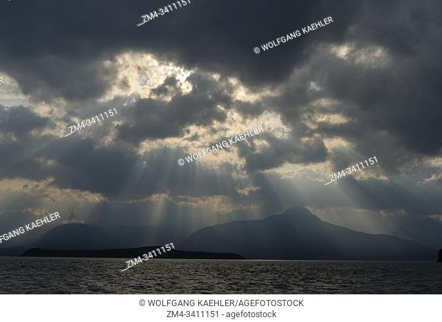 Dramatic clouds and sky at the northern tip of ninety-mile-long Admiralty Island, which is bordered by Stephens Passage on the east and Chatham Strait on the...
