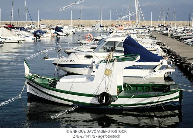 A green boat view in the Altea port, Alicante, Spain