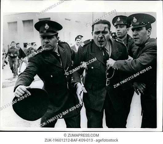 Dec. 12, 1960 - Anti-Government Demonstrations In Athens Injured Policemen Helped Away: There were serious anti-Government demonstrations in the street of...