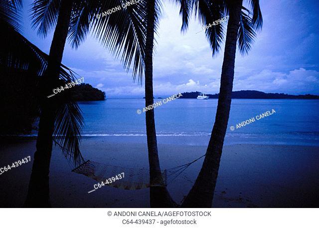 Tropical beach, palms and hamock. Coiba Island National Park, Coiba Island, Panama