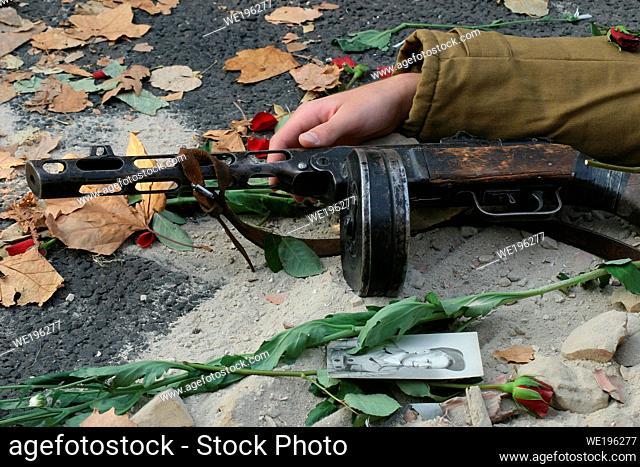 Fallen soldier with drum machine gun