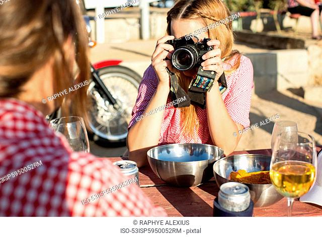 Woman taking picture of boyfriend