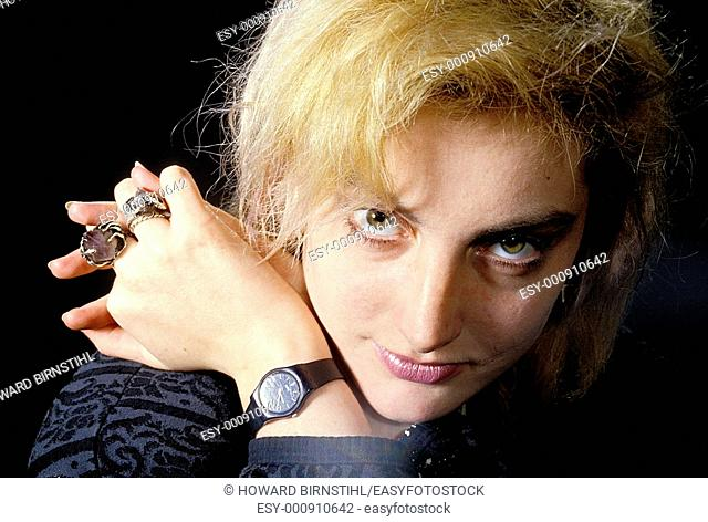 close up of blond model with fashion jewellery staring into the camera