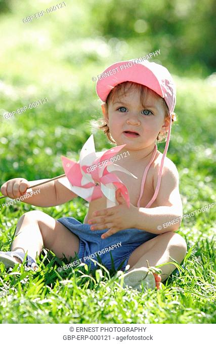 Baby, 1 year; Sitting, grass, Isolated