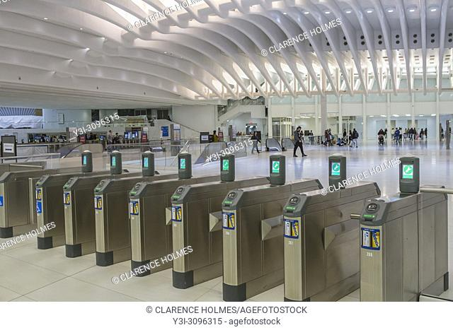 Turnstiles await passengers at the PATH station in the World Trade Center Transportation Hub in New York City