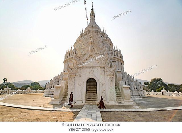 Buddhist monks walk around the Hsinbyume Pagoda, Mingun, Sagaing, Myanmar