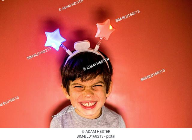 Mixed race boy wearing headband with stars