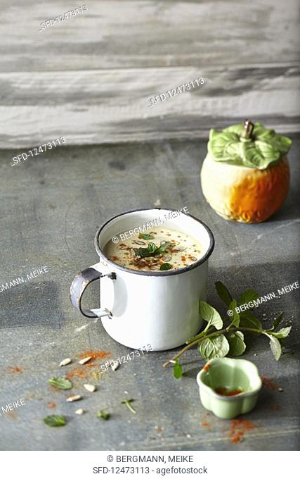 Energy explosion cup of soup: coconut milk soup with dates, apple and mint