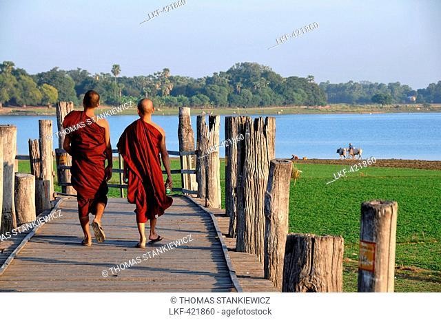 On the U Bein bridge, Amarapura near Mandalay, Myanmar, Burma, Asia