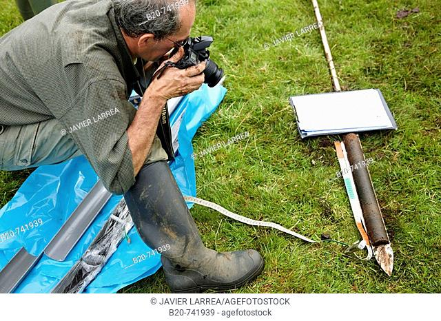 Taking pictures of peat sample, climate change research, Neiker-Tecnalia, Unit of Environment, Belate, Navarra, Spain