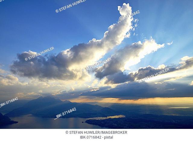 Atmospheric clouds above Lake Lucerne, Mount Pilatus at back, Vitznau, Canton of Schwyz, Switzerland