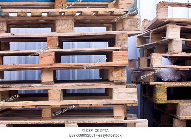 it is a shot of piles of wooden pallets