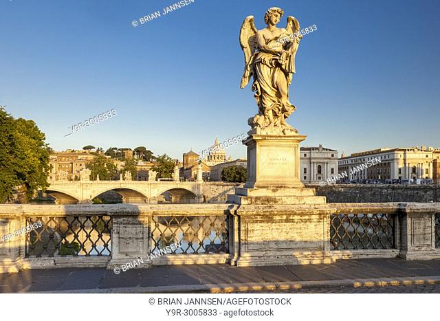 Early morning Angel on Ponte Sant Angelo with St. Peter's Basilica beyond, Rome Lazio Italy