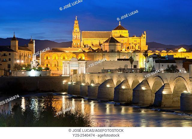 Arab mosque, Roman bridge and Guadalquivir river at dusk, Cordoba, Region of Andalusia, Spain, Europe