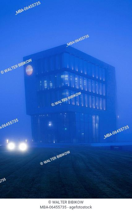 Germany, Baden-Wurttemburg, Black Forest, Titisee-Neustadt, Titisee village, Testo company building, dawn with fog