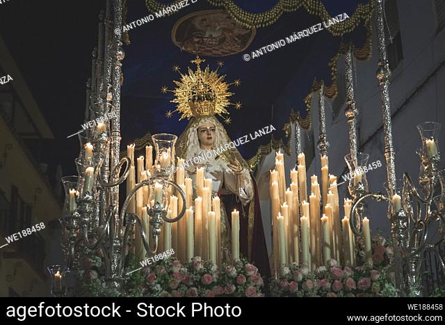 Virgen Maria in procession in Marbella at the holy week , candles an throne at night in Spain