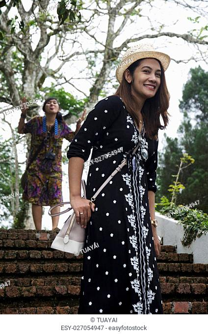 Travelers thai women portrait for take photo on stairway at Penang Hill in Penang, Malaysia