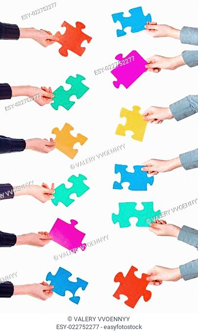 female hands with different puzzle pieces