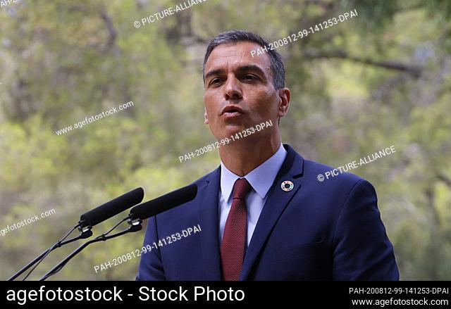 12 August 2020, Spain, Palma: Pedro Sanchez, Prime Minister of Spain, speaks at a press conference after his meeting with King Felipe VI at the Palacio de...