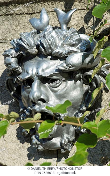 Paris 16th district. Garden of the greenhouses of Auteui. One of 14 mascarons of the garden, Auguste Rodin's worksl