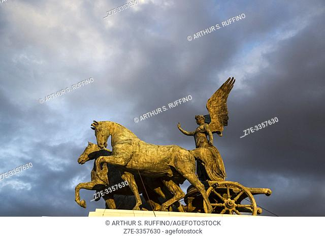Statue of Goddess Victoria on a Quadriga (Winged Victory Statue) at sunset. Victor Emmanuel II Monument (Monumento Nazionale a Vittorio Emanuele II)