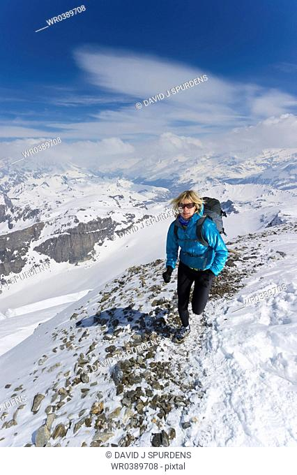 A women jogging on high Alpine mountains