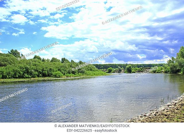 Landscape with river in summer. River landscape with white clouds. Beautiful summer landscape. Travel concept. Vacation concept. summer holidays
