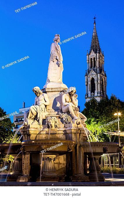 France, Occitanie, Nimes, Esplanade Charles De Gaulle with fountain at dusk