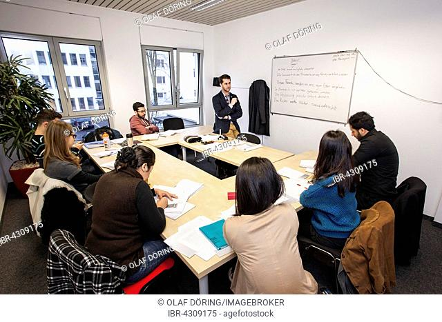 Foreigners in German lessons in an international class, language class, Germany