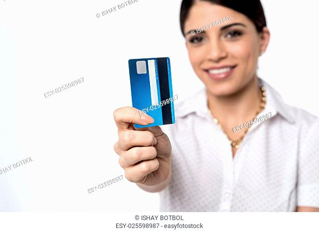 Happy woman showing credit card, focus on card