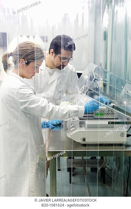 Putting sample in stirrer, laminar flow cabinet, Synthesis Laboratory, CIC nanoGUNE Nanoscience Cooperative Research Center, Donostia, Gipuzkoa, Euskadi, Spain