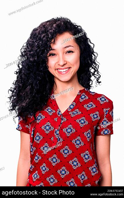 Young woman smiling with curly black hair isolated on white