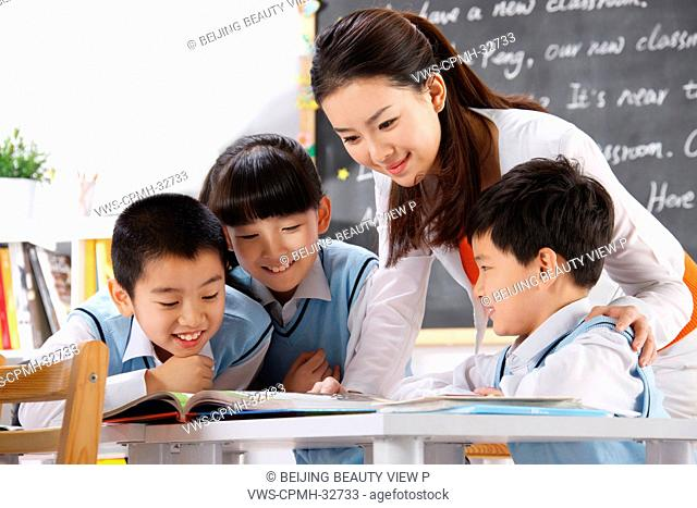 Elementary school students with a teacher in class