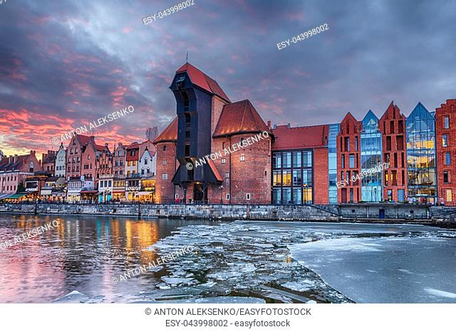 Gdansk Zuraw, a famous sight on the bank of Motlawa river, winter sunset