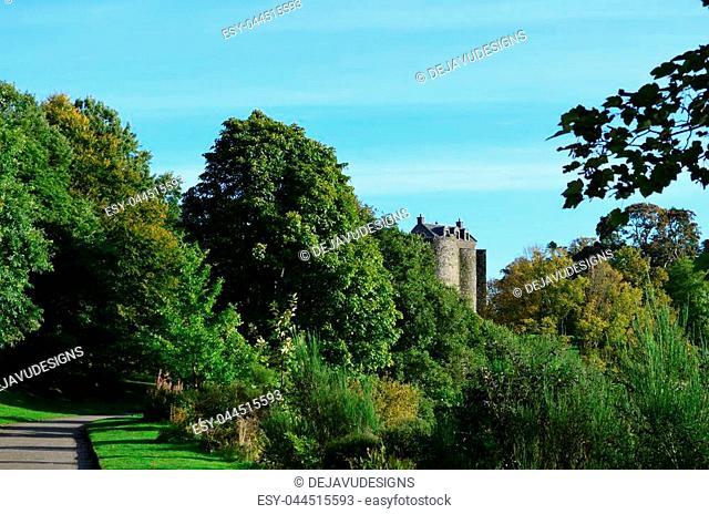 Lush green landscape surrounding Dunstaffnage Castle in Scotland