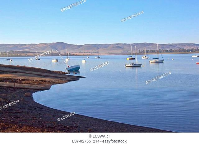 Early morning view of boat slipway on Midmar dam against Yachts anchored in water at Howick, Kwa-Zulu Natal, South Africa