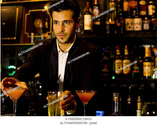 Bartender serving cocktails
