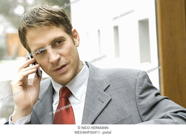 Businessman using his mobile phone
