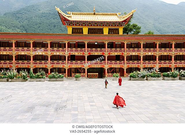 Kangding, Sichuan province, China - The view of Namo monastery, a famous Tibetan Buddhism Temple with some monks in the daytime