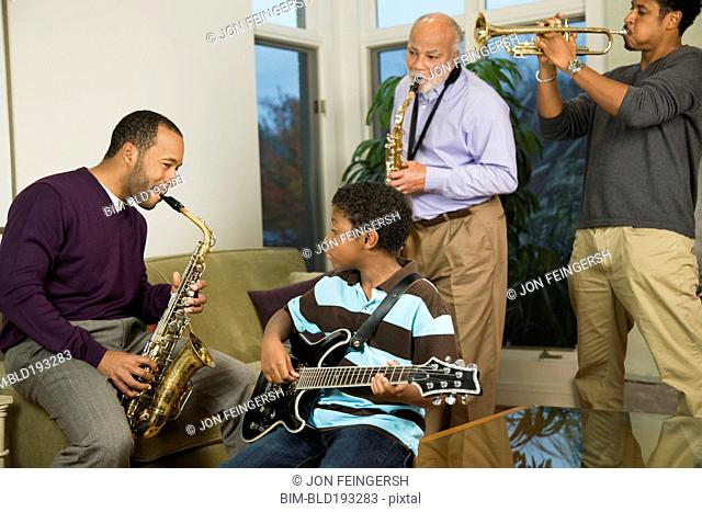 African American family playing musical instruments together